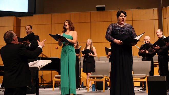 "Lead singers Steve Williams, left, Courtney Huffman Frye and Alison Meuth and choir members perform during the 2018 world premiere of the original musical ""Ruth"" at Grace Church in Morton. Phil Witzig is the conductor."