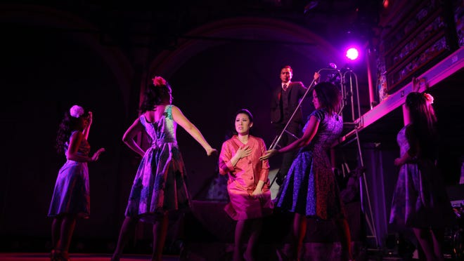 """Ruthie Ann Miles, center, during a performance of """"Here Lies Love,"""" in New York. When it was in the Public Theater's LuEsther Hall last year, the show had a capacity of 160. This time, Dave Byrne and a group of commercial producers are hoping to push that number to 200. Byrne, who teamed up with Fatboy Slim on the music, has been shepherding the show for 10 years."""