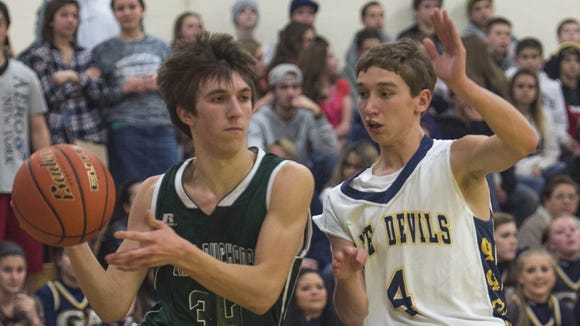 Greencastle's Brandon Stuhler, right, plays defense against Cody Tacker, of James Buchanan, earlier this season. Stuhler and the Blue Devils tried to play a diamond-and-one against Reading in the first round of the District 3 Class AAAA playoffs.