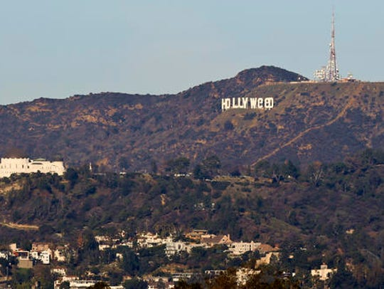 The Hollywood sign is seen vandalized Sunday, Jan.