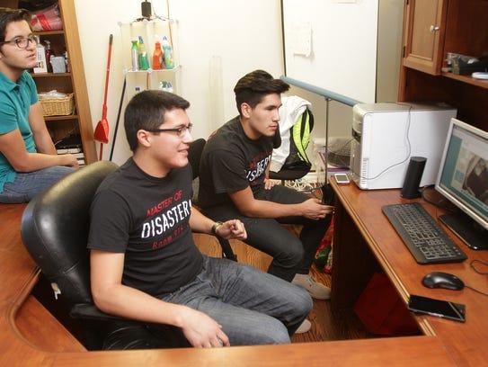 Luis Villagomez, left, Joel Delgado and Sal Garcia,