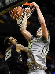 Vanderbilt's Luke Kornet (3) dunks over Missouri's