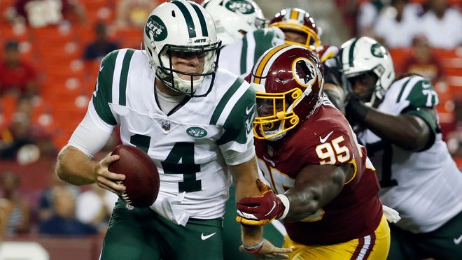 New York Jets quarterback Sam Darnold (14) is sacked by Washington Redskins defensive tackle Da'Ron Payne (95) during the first half of a preseason NFL football game Thursday, Aug. 16, 2018, in Landover, Md. (AP Photo/Alex Brandon)