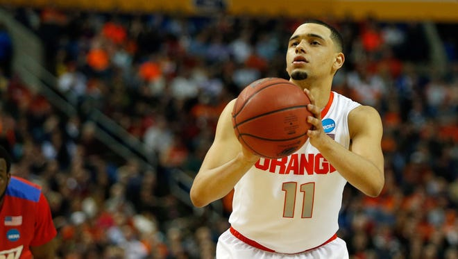 Syracuse Orange guard Tyler Ennis (11) against the Dayton Flyers during the third round of the 2014 NCAA Tournament at First Niagara Center.