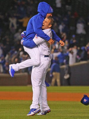 Chicago Cubs first baseman Anthony Rizzo (44) celebrates with center fielder Albert Almora Jr. (5) after hitting the game-winning single during the ninth inning against the Los Angeles Dodgers at Wrigley Field.