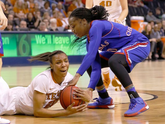 Texas guard Brianna Taylor, left, and Kansas guard Jayde Christopher vie for a loose ball during the first half of an NCAA college basketball game in the Big 12 Conference women's tournament in Oklahoma City, Saturday, March 5, 2016. (AP Photo/Alonzo Adams)