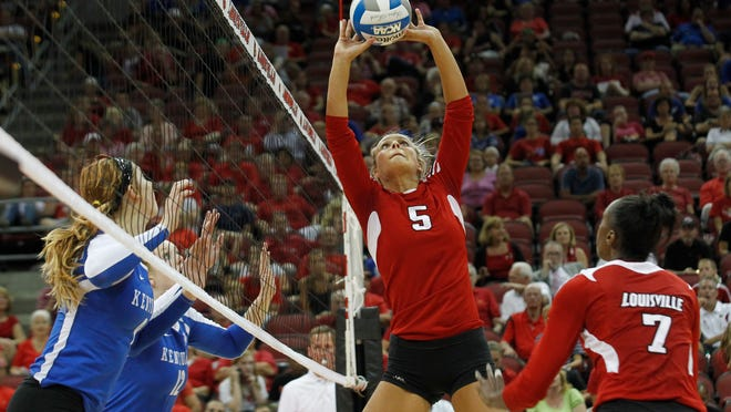 The University of Louisville's Katie George sets the ball against the University of Kentucky during the 2012 rivalry volleyball match at the KFC Yum! Center.
