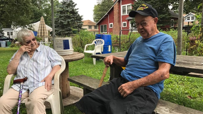 Shirley and Donald Collins, of Pequannock, relaxing in their Second Street back yard. The couple and their nine children moved into the home in 1957.