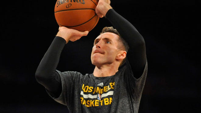 Los Angeles Lakers guard Steve Nash (10) practices before the Lakers play against the Utah Jazz at Staples Center in Los Angeles on Oct. 19, 2014.