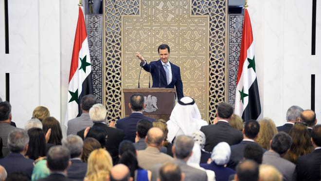 "A handout picture released on July 26, 2015 by the official Syrian Arab News Agency (SANA) shows President Bashar al-Assad waving to the crowd following a speech in the capital Damascus. Al-Assad acknowledged the shrinking ranks of his government's army in a rare public speech, but insisted the force was still capable of beating rebel fighters. AFP PHOTO / HO /SANA == RESTRICTED TO EDITORIAL USE - MANDATORY CREDIT ""AFP PHOTO / HO /SANA"" - NO MARKETING NO ADVERTISING CAMPAIGNS - DISTRIBUTED AS A SERVICE TO CLIENTS ==HO/AFP/Getty Images"