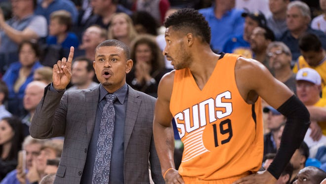 Phoenix Suns head coach Earl Watson (left) instructs next to guard Leandro Barbosa (19) against the Golden State Warriors during the fourth quarter at Oracle Arena. The Warriors defeated the Suns 133-120.