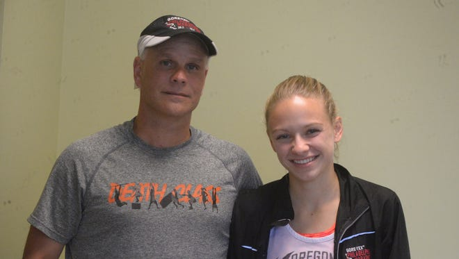 Seton Catholic cross country runner Jenna Barker, left, with father and head coach Todd Barker.