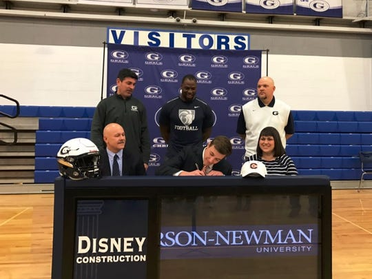 Grace Christian wide receiver Zac Headrick, front row center, signs to play at Carson-Newman.
