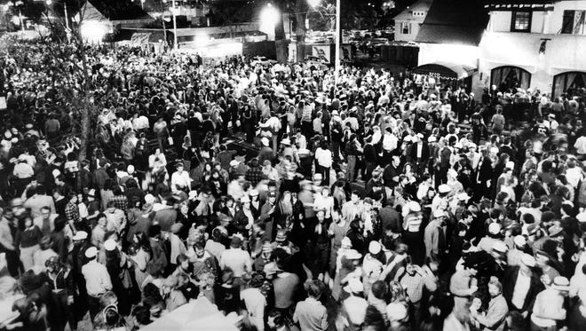 Revelers pack Madison Avenue in Overton Square during the annual St. Patrick's Day Pub Crawl on March 17, 1983.
