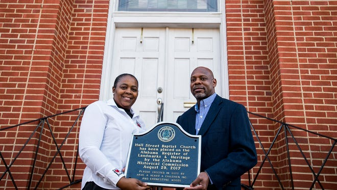 Earnestine Woods, of Have a Heart 4 Children, presents Hall Street Baptist Church pastor Leonard Commack with an Alabama Register of Landmarks and Heritage plaque at the church in Montgomery, Ala. on Wednesday March 14, 2018.