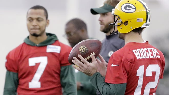 Green Bay Packers quarterback Aaron Rodgers (12) tosses a football during practice at the Don Hutson Center on Wednesday, December 6, 2017 in Ashwaubenon, Wis.