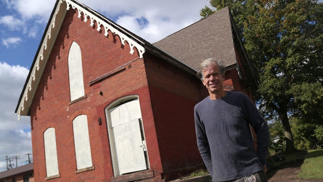 Steve McQuillin of Hayesville recently purchased this 1868 Gothic revival house on the corner of Fifth and Walnut Street in Mansfield. He plans on turning the house into a two apartment building by utilizing the state preservation tax credit.