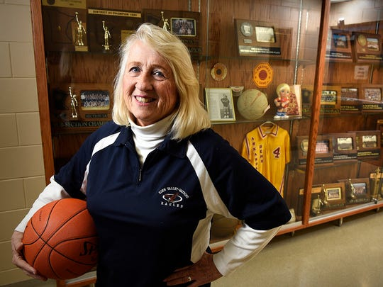 """Eden Valley-Watkins school district has named the high school gym after local athlete Elvera """"Peps"""" Neuman. In this February 2015 photo, Neuman is standing by a glass case displaying her trophies at her alma matter."""