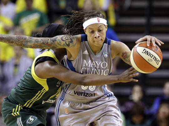 The Seattle Storm's Jewell Loyd, left, fouls the Minnesota Lynx's Seimone Augustus late in the second half on May 22 in Seattle.