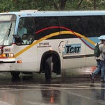 A TCAT bus turns from East Avenue onto Campus Road on the Cornell University campus.