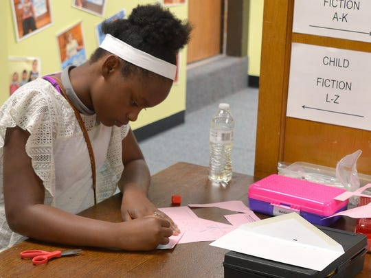 Origami was among the activities available to kids at Farnsworth Public Library's 115th anniversary open house on June 28.