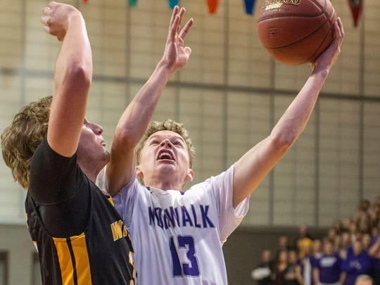 Norwalk's Bowen Born goes up for a shot while guarded by Waukee's Nick Baur last season.