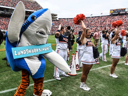 Aubie, the mascot for Auburn University, dresses as a shark during the game against Mississippi at Jordan-Hare Stadium in Auburn, Ala. on Saturday, October 7, 2017. The University of Mississippi announced on Friday that its on field mascot will become a land shark, which will replace a black bear. (Bruce Newman/The Oxford Eagle via AP)