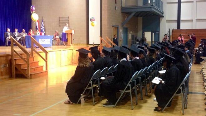 "Dutchess BOCES Adult Education Administrator Mary Fayne Simpson urges Dutchess County High School Equivalency program graduates to ""keep learning."""