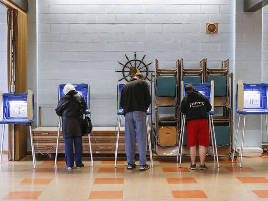 Voters mark their ballots in Manitowoc's 10th District