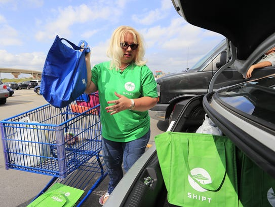 Shipt shopper Laura McKenna loads up her car with groceries