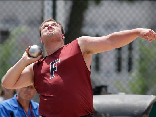 Fond du Lac's Colton Wasieleski throws in the Division 1 shot put finals Friday during the WIAA state track and field meet at Veterans Memorial Stadium in La Crosse.