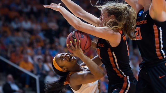 Tennessee's Anastasia Hayes, left, is defended by Oregon State's Katie McWilliams, center, and Marie Gülich during Sunday's game.
