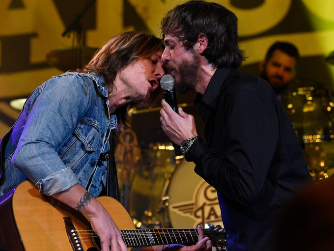 Chris Janson performs with Keith Urban at the Ryman