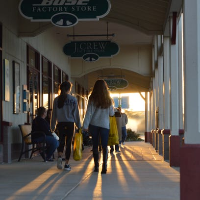 Bargain hunters shop at Tanger Outlets in Rehoboth