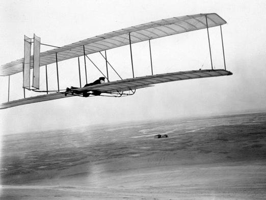 Wilbur Wright flies aloft in the 1902 glider soon after