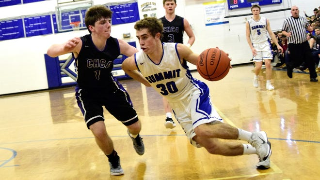 Summit Country Day's Sam Martin (30) speeds past CHCA's Michael Nelson as the Silver Knights roll past the Eagles 64-37, January 13.
