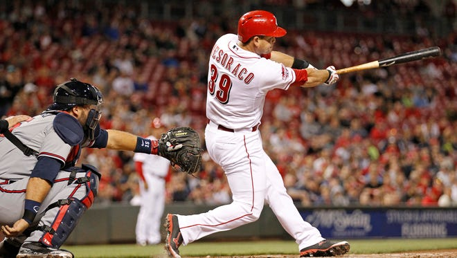 Cincinnati Reds catcher Devin Mesoraco (39) hits a walk-off double to right field in the bottom of the ninth inning of the MLB game between the Cincinnati Reds and the Atlanta Braves at Great American Ballpark in Cincinnati, Ohio, on Tuesday, May 12.