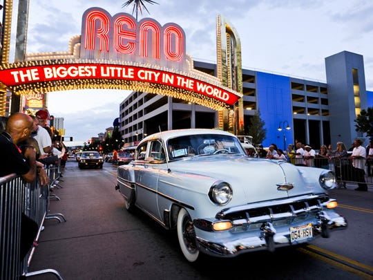 Cars pass under the Reno Arch on during Hot August