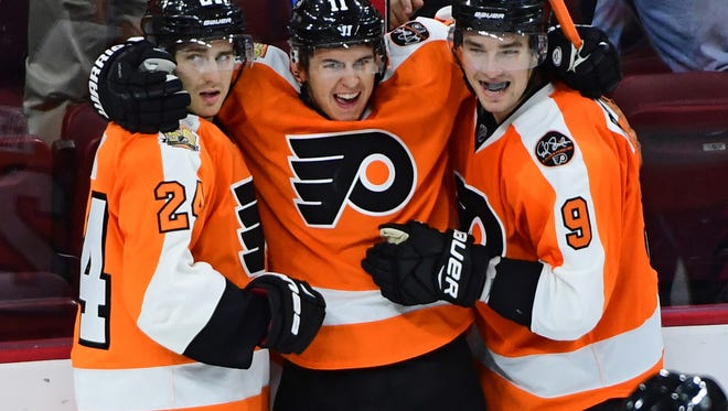 Travis Konecny, center, scored his first NHL goal Tuesday to spark the Flyers' comeback.