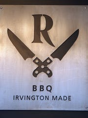 An interior sign at Revenge BBQ on Main Street in Irvington,