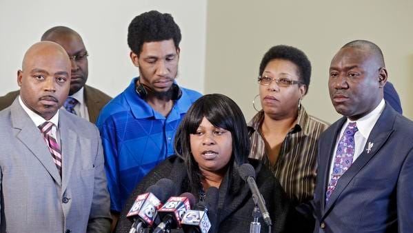 Samaria Rice, center, speaks about the investigation into the death of her son Tamir Rice, at a news conference with attorneys Walter Madison, left, and Benjamin Crump in Cleveland, Tuesday, Jan. 6, 2015. A Cleveland police officer fatally shot 12-year-old Tamir Rice on Nov. 22, 2014. (AP Photo/Mark Duncan)
