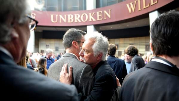 Singer Joe Bonsall gets a hug after a public announcement that the Oak Ridge Boys would be 2015 inductees into the Country Music Hall of Fame.