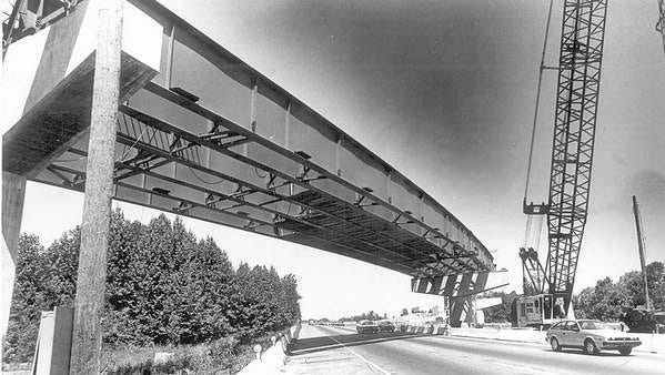 The overpass connecting Routes 55 and 42 undergoes construction in 1984.