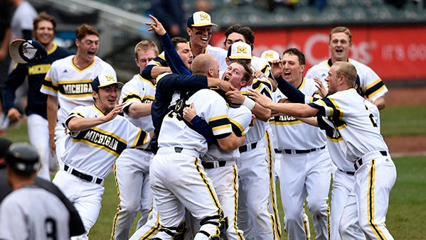 Michigan players celebrate the final out, a Big Ten title and a spot in the NCAA tournament.