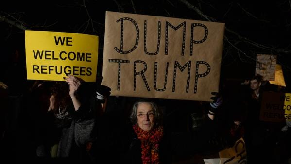 PORTSMOUTH, NH - DECEMBER 10: A woman holds a sign outside the Sheraton Portsmouth Harborside Hotel where Republican presidential candidate Donald Trump is due to speak at the New England Police Benevolent Association Meeting December 10, 2015 in Portsmouth, New Hampshire. Trump has made incendiary remarks regarding Muslims recently, saying he would implement a ban on all Muslims entering the United States. (Photo by Darren McCollester/Getty Images) *** BESTPIX ***
