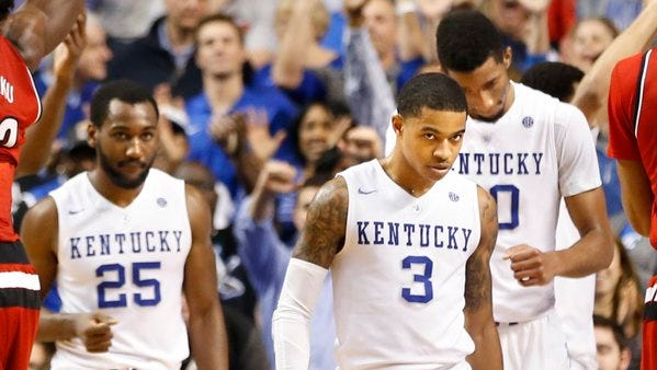Kentucky's Tyler Ulis was deadly from the outside as the Wildcats turned back the Cardinals, 75-73.