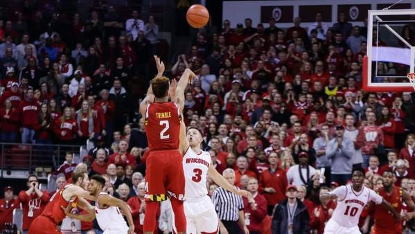Maryland's Melo Trimble (2) shoots the game-winning basket over Wisconsin's Zak Showalter (3) in the final seconds of their college basketball game Saturday in Madison. Maryland won 63-60.