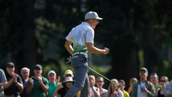 Oregon's Aaron Wise celebrates a birdie on the 17th hole at the NCAA Division I men's college golf championship at Eugene Country Club in Eugene, Ore., Monday, May 30, 2016. (Brian Davies/The Register-Guard via AP) MANDATORY CREDIT