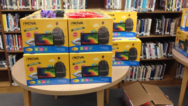 Comeaux High received a donation of 146 iNova tablet computers on Wednesday.