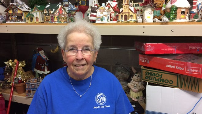 Mary Jo Ragaller, 80, of Ankeny will fix you up with decorations cheap at St. Vincent de Paul thrift store in Des Moines.